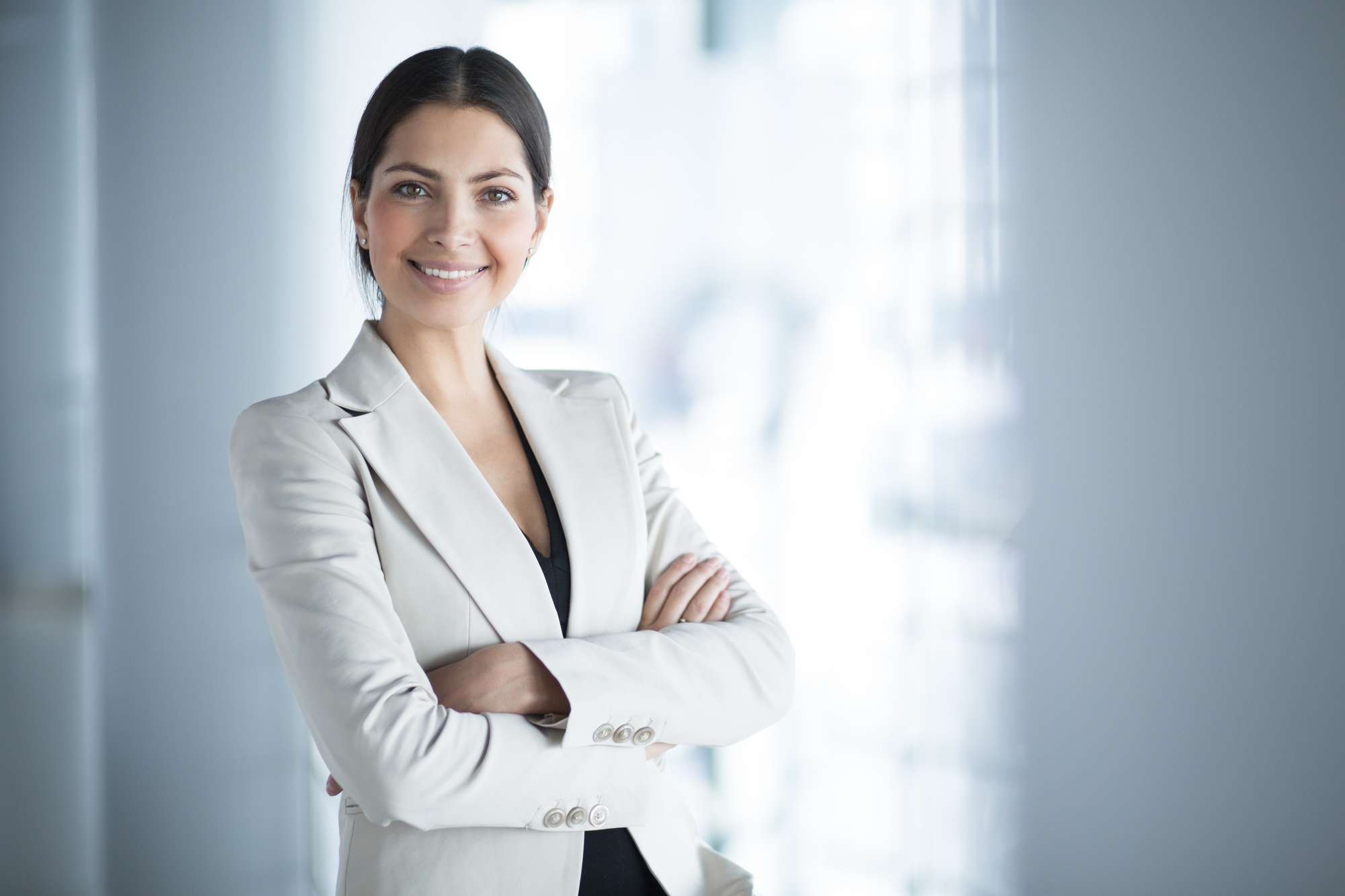 smiling-female-business-leader-with-arms-crossed